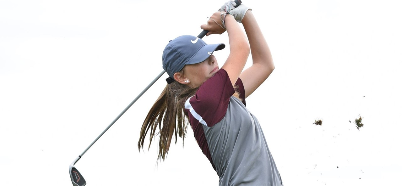 One of our girl golfers mid-swing