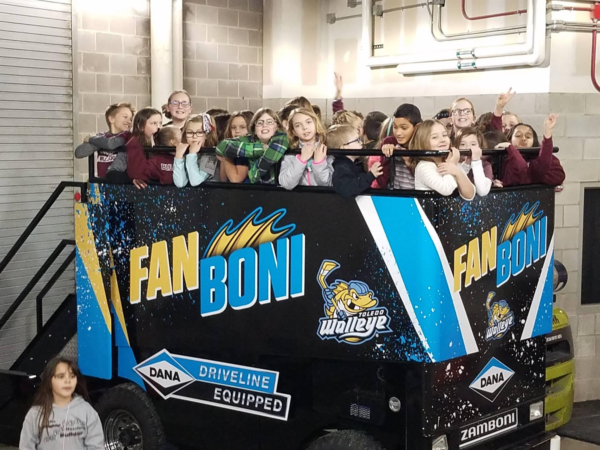 Eagle Point choir riding Fan Boni at Walleye game.