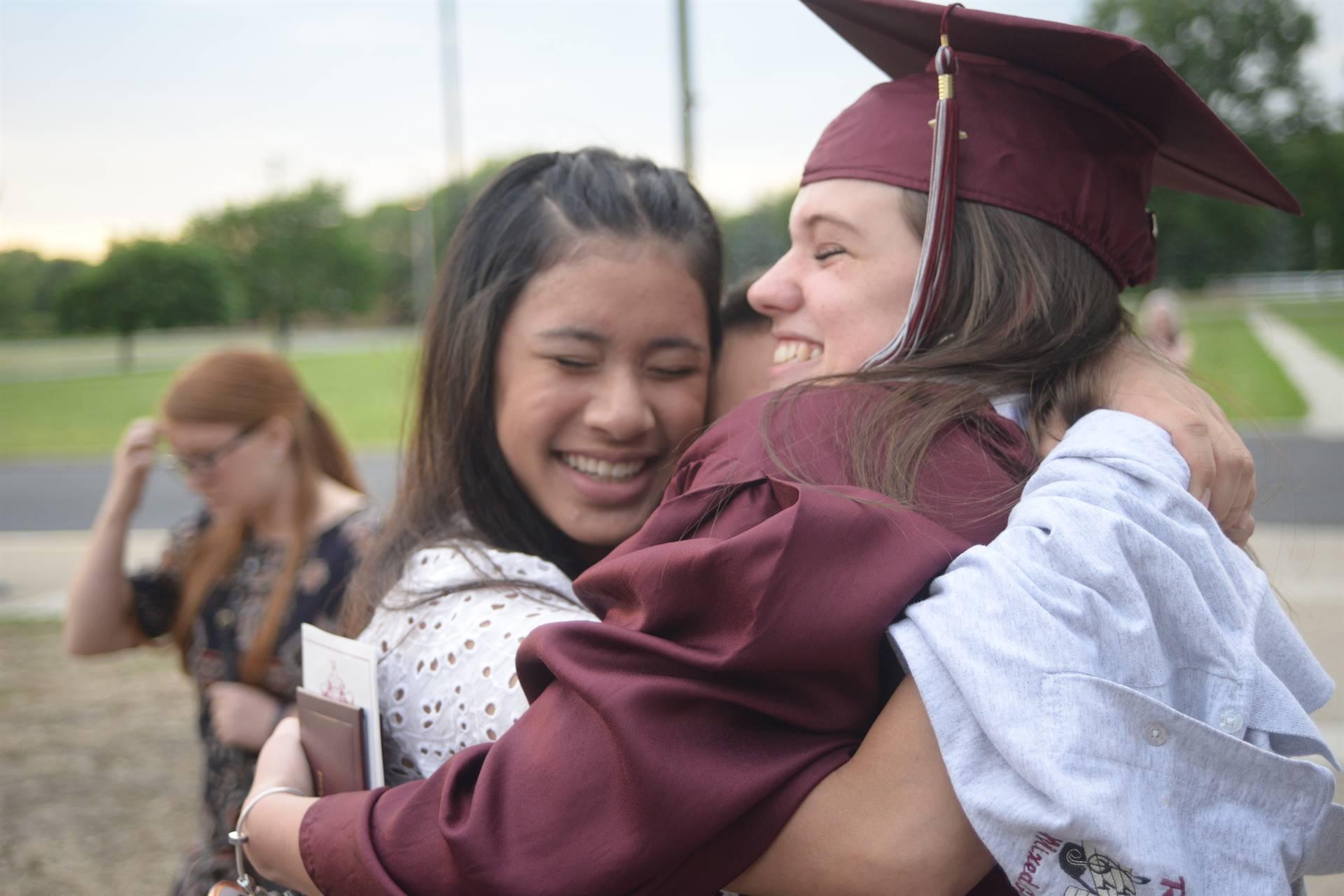 Hug between two RHS graduates