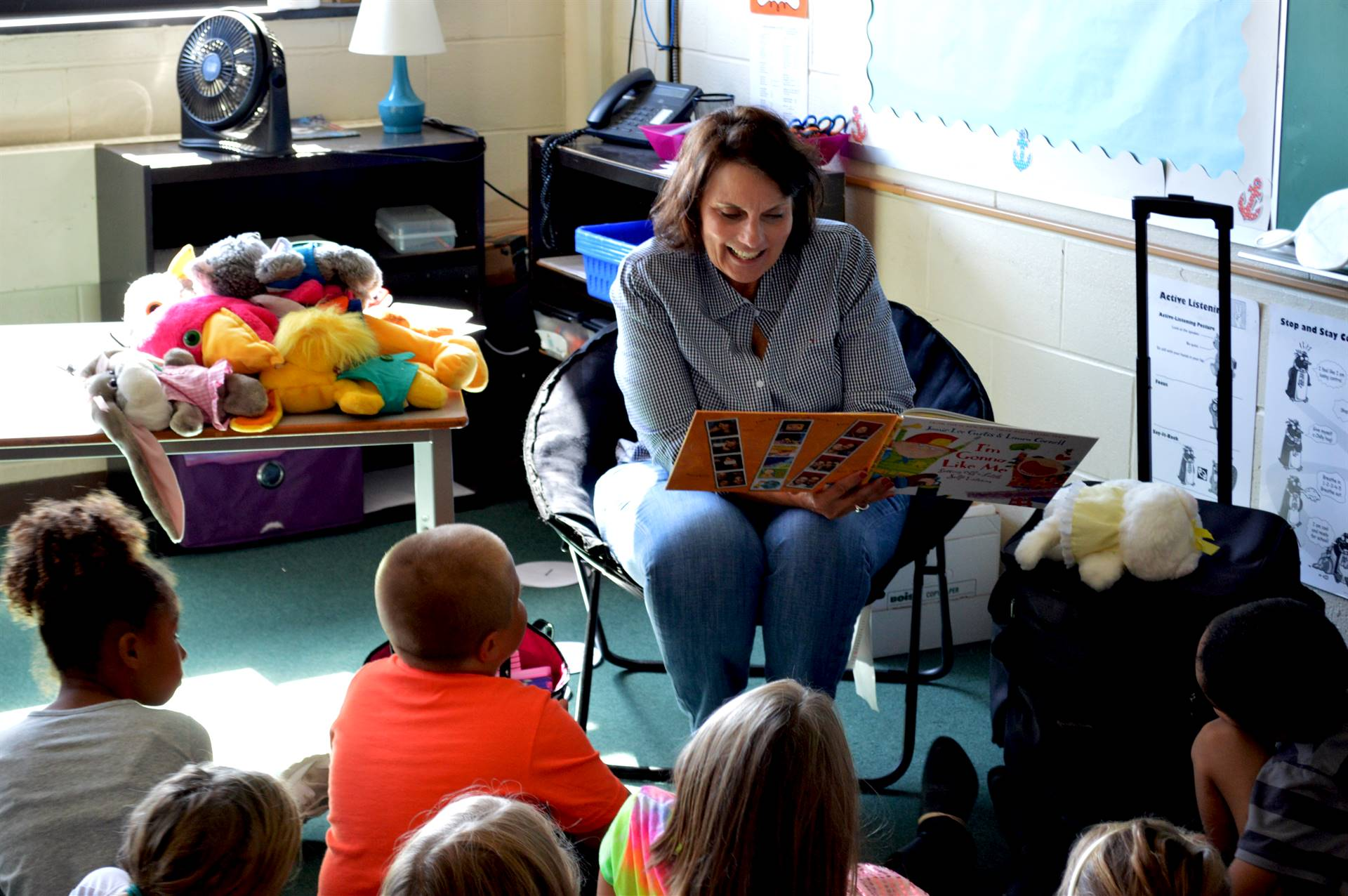 Teacher reading to students in class.