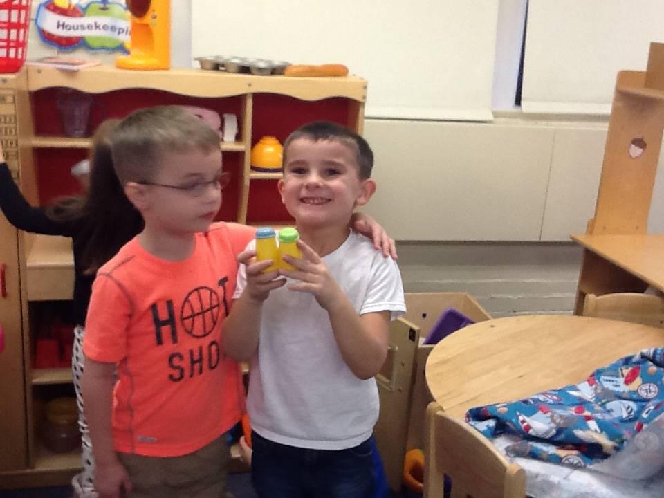Two preschoolers having fun.