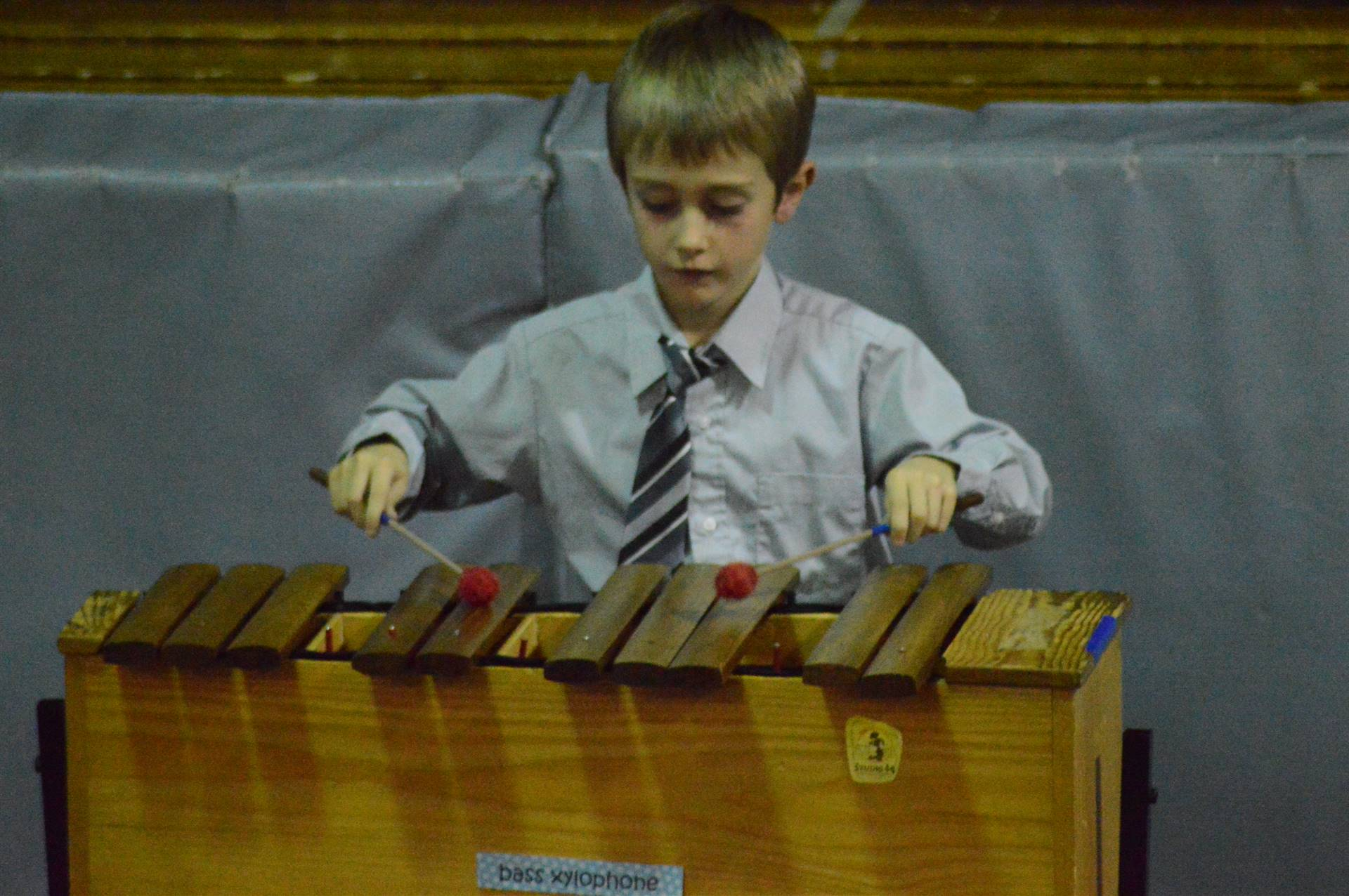 Student performing during music program at Glenwood.