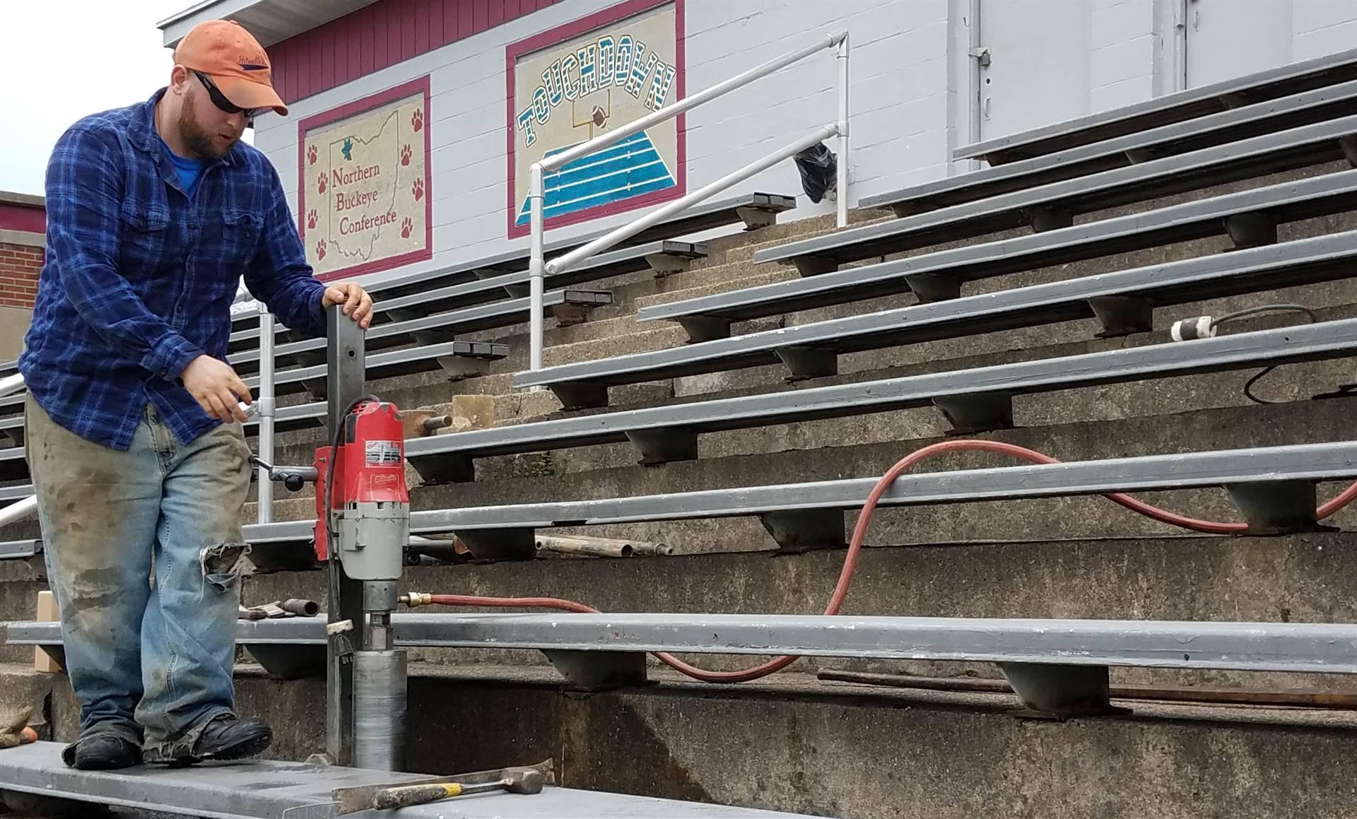 Working doing maintenance to football stadium