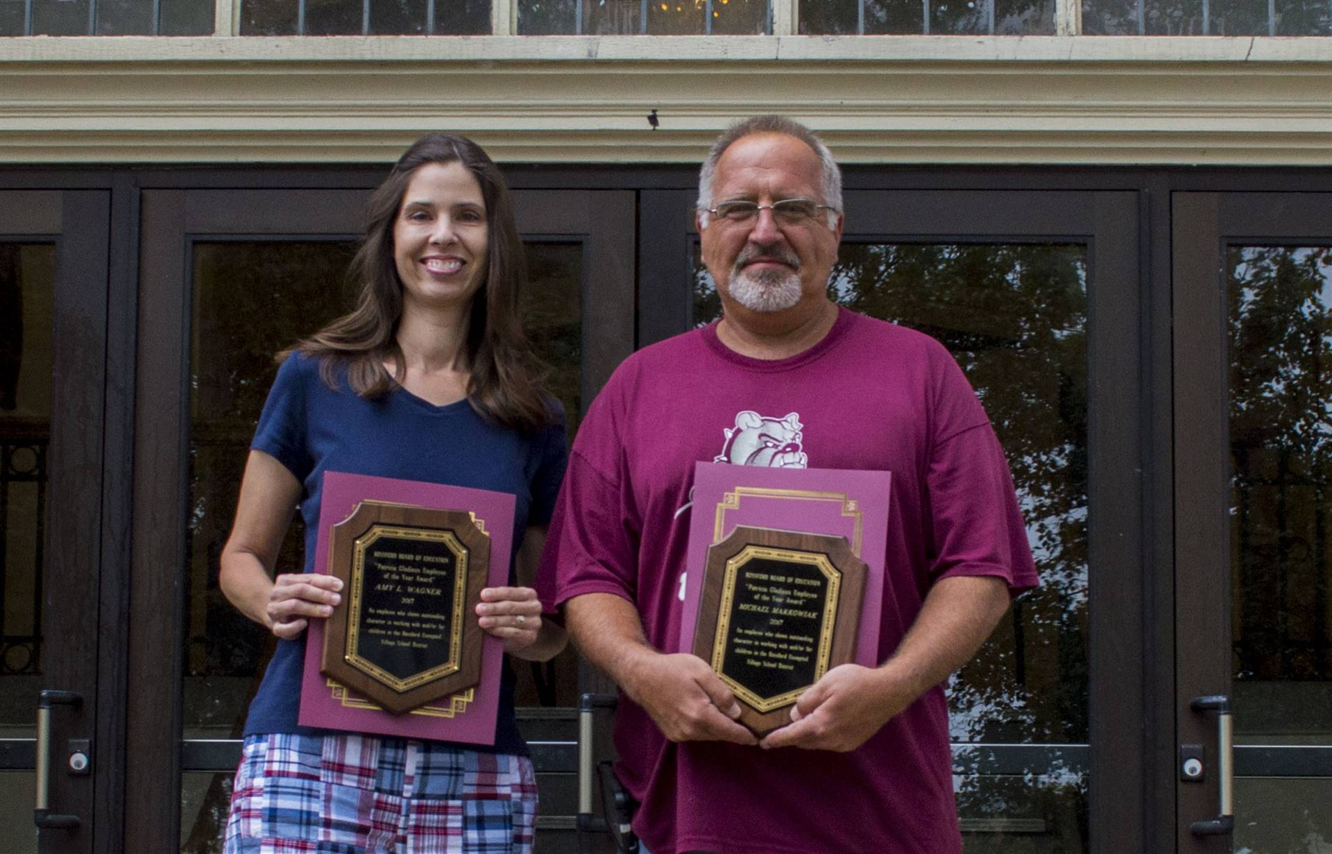Two employees with annual honors