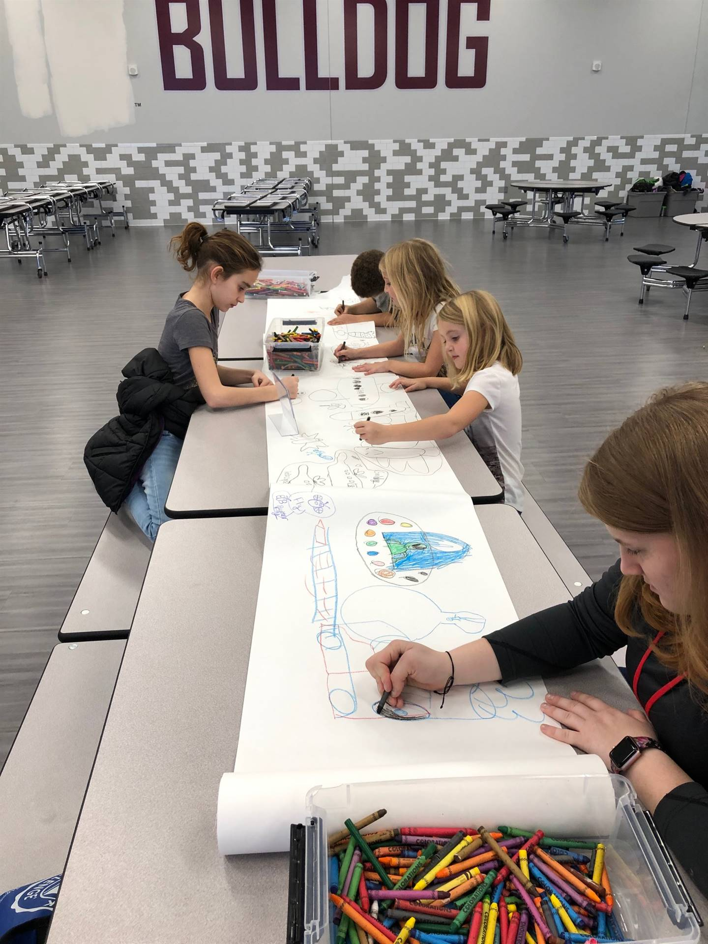 Students drawing in the cafeteria
