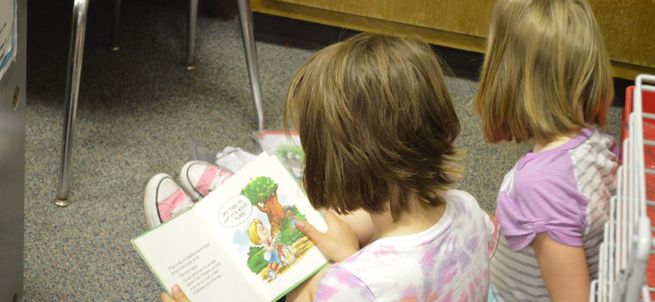 Children reading books in kindergarten