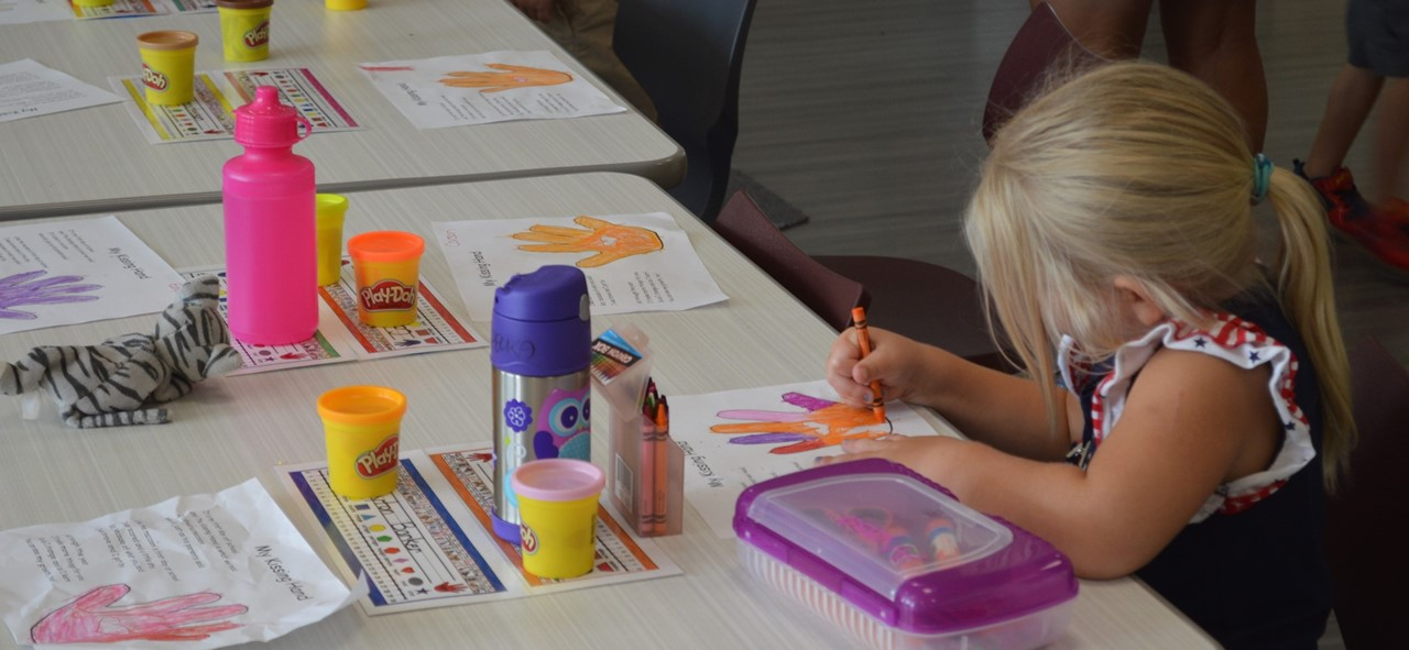 Student coloring a picture.